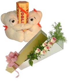 Two Teddies with six roses and tobler chocolates