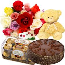 50 red roses, teddy, 1/2 kg cake,16 packs ferrero rocher